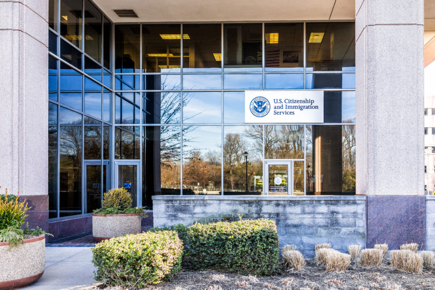 Fairfax: USCIS US United States Citizenship and Immigration Services field main office entrance in Virginia with sign